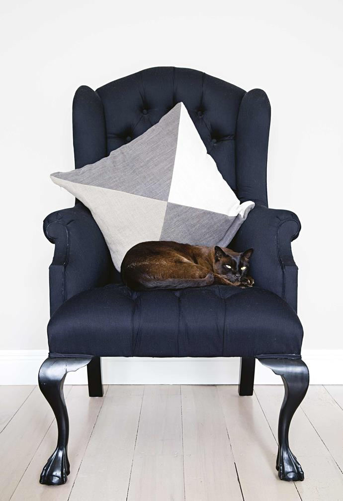 **Guest bedroom** Bo the cat loves curling up in this plush armchair.