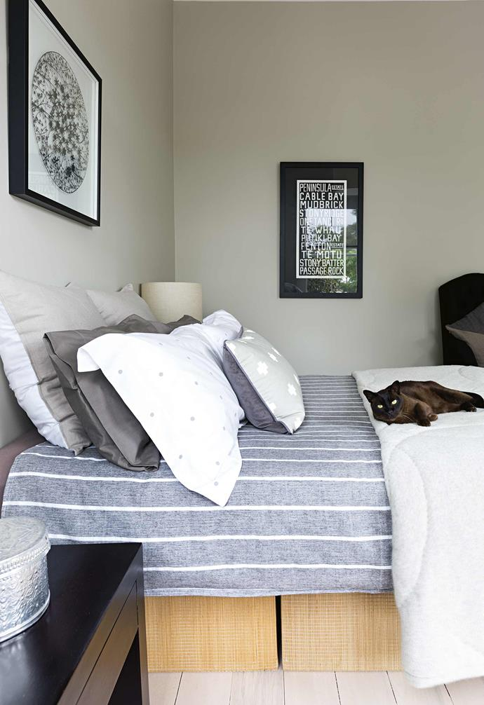 **Guest Bedroom** Blues, whites and greys combine for a tranquil space.