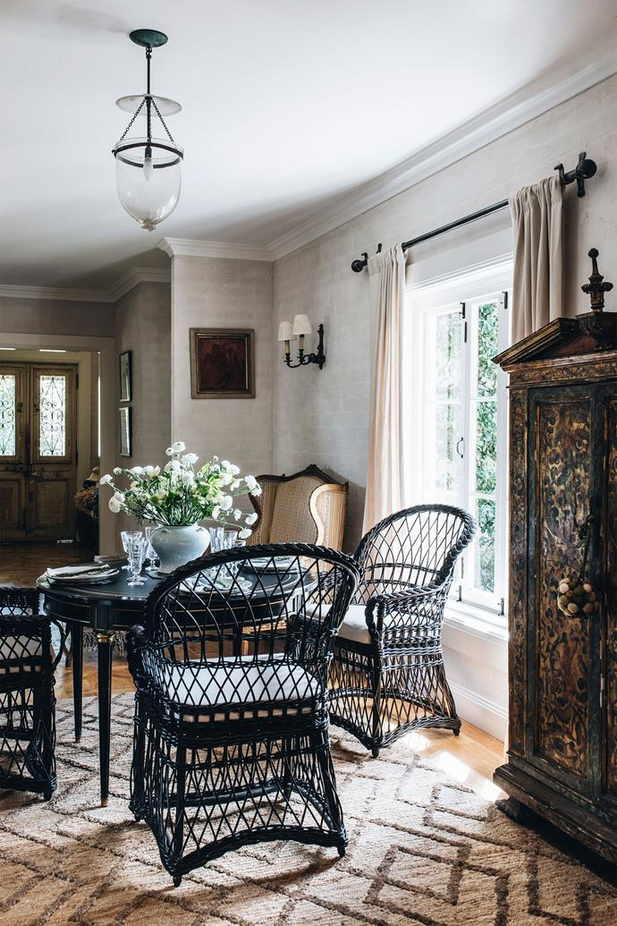 """Melissa calls the huge hall """"the spine of the house"""" and it holds a dining table where they often eat."""