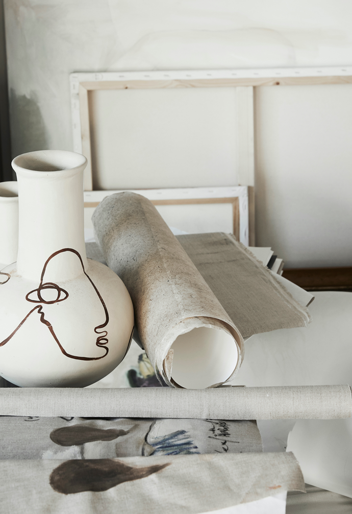 Alex's signature line drawing wraps organically around a terracotta vessel.
