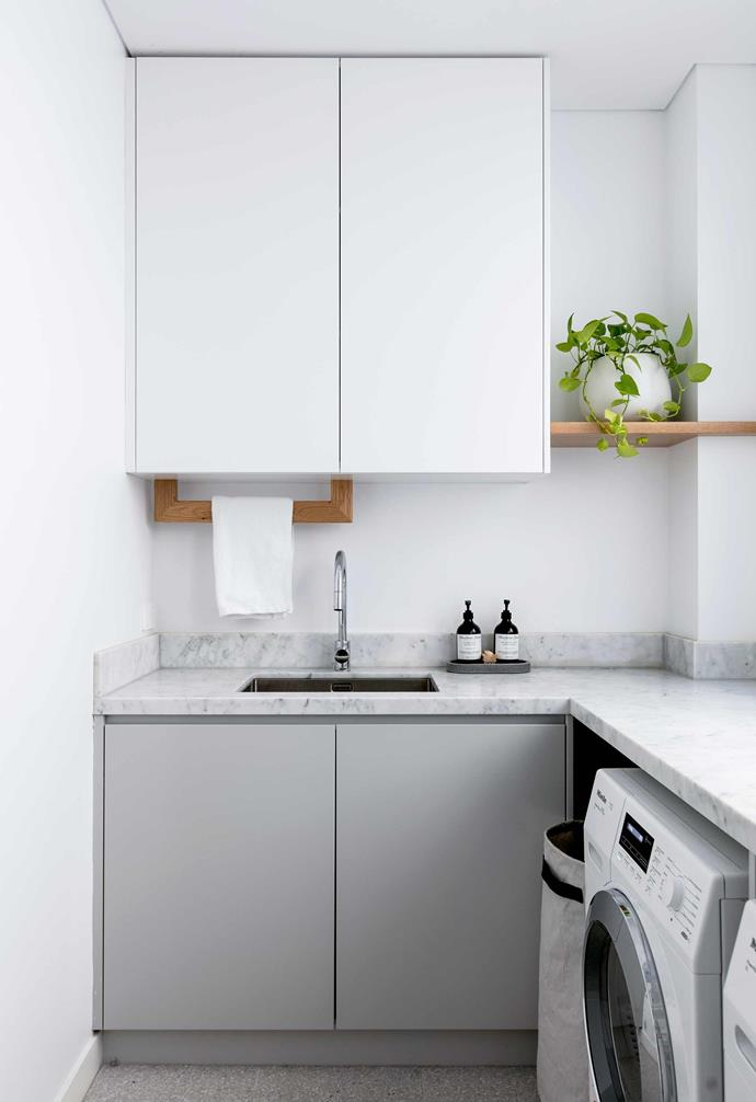 "**Laundry**  The house's material palette is big on Carrara marble, which is perfect for high-traffic spaces like this. Floor tiles, [Surface Gallery](https://surfacegallery.com.au/|target=""_blank""