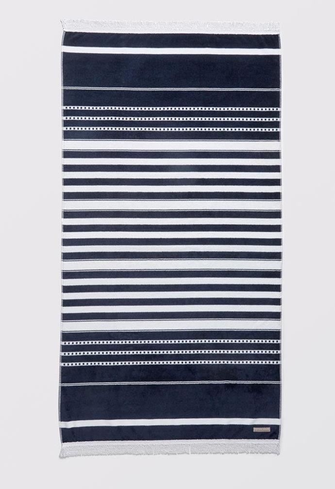 "Ravello Beach Towel, $69.95, [Bed Bath 'N Table](https://www.bedbathntable.com.au/bath/towels/beach-towels/ravello-beach-towel-navy-white-16568001|target=""_blank""