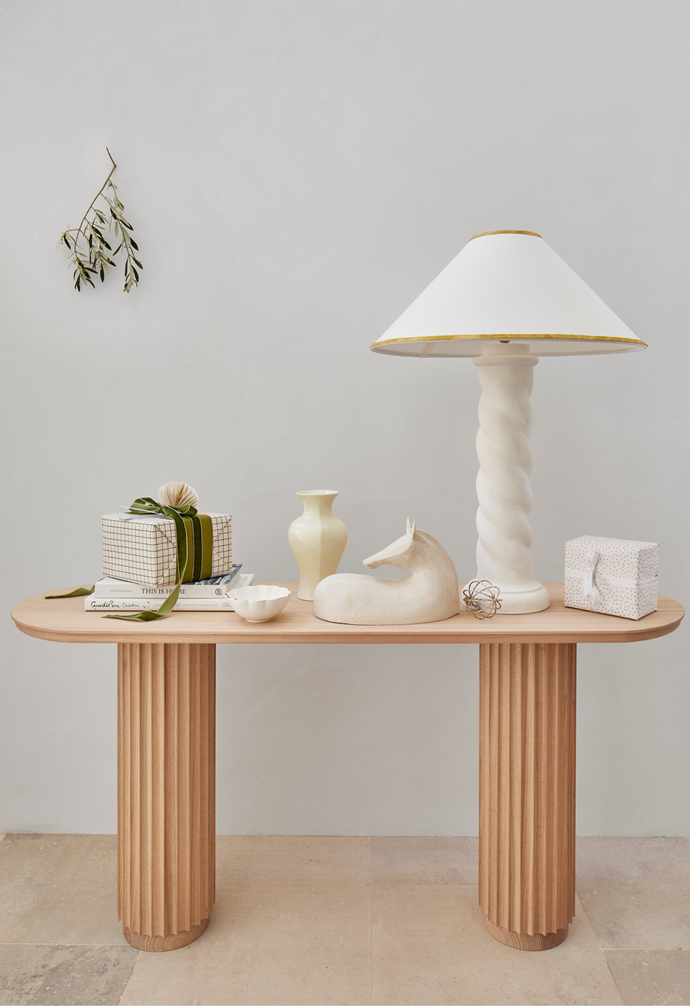Underline console, $1995, Smith Made. This is Home: The Art of Simple Living book by Natalie Walton, $60, Norsu Interiors. Grandiflora Celebrations book by Saskia Havekes, $69.99. Aerin scallop nesting dish, $725 for set of 3, Becker Minty. Del Rio lamp and Coolie white linen shade with ochre trim, $1500, Lucy Montgomery.