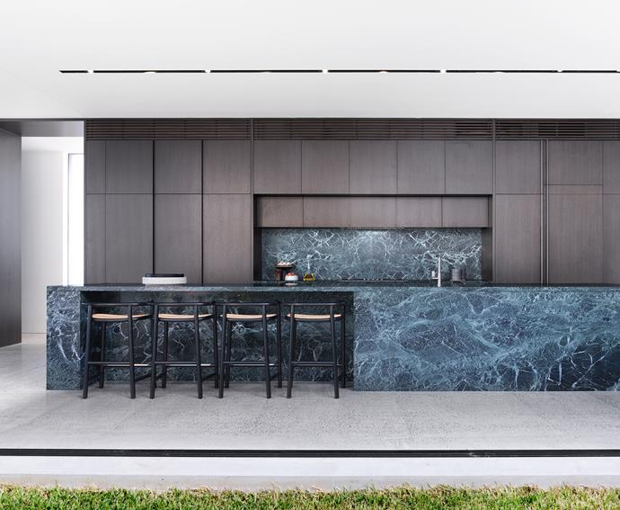 The 5.4-metre-long island bench is clad in glamorous Verde Tinos marble from Euro Marble. Smoked oak joinery. Gebrüder Thonet Vienna 'Single Curve' stools from Space. When Objects Work 'HH' bowl from Hub.