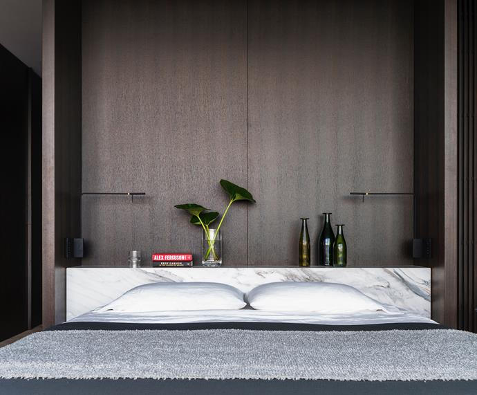 The master bed has a bedhead in Calacatta marble from Euro Marble. Viabizzuno 'Royal Parete' reading lights. Society Limonta throw and bed linen from Ondene.