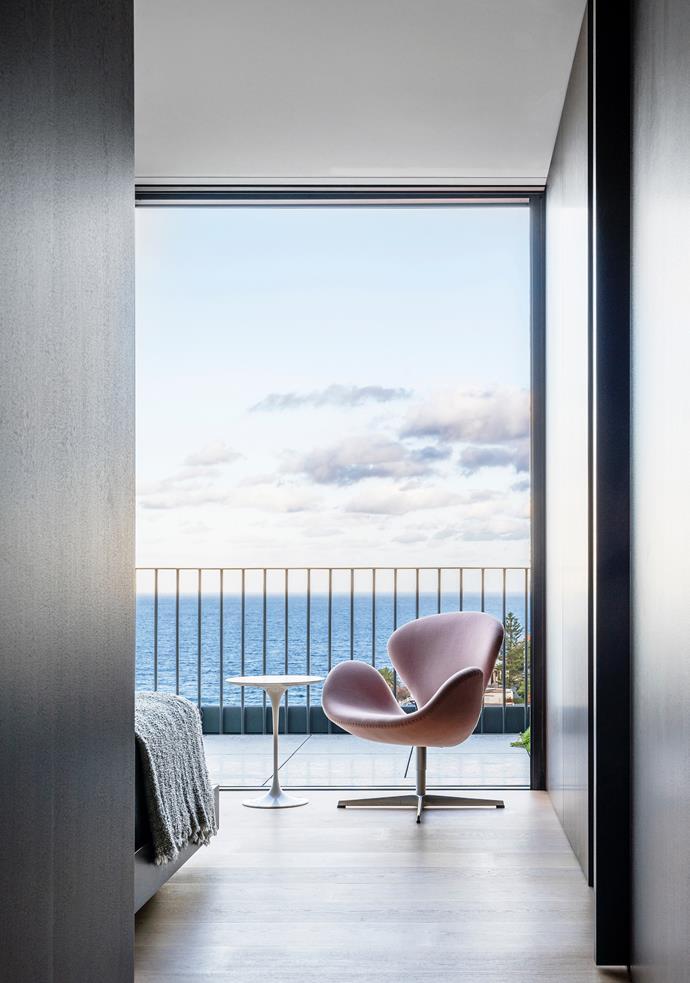 Fritz Hansen 'Swan' chair from Cult. Knoll 'Saarinen Tulip' side table from De De Ce.