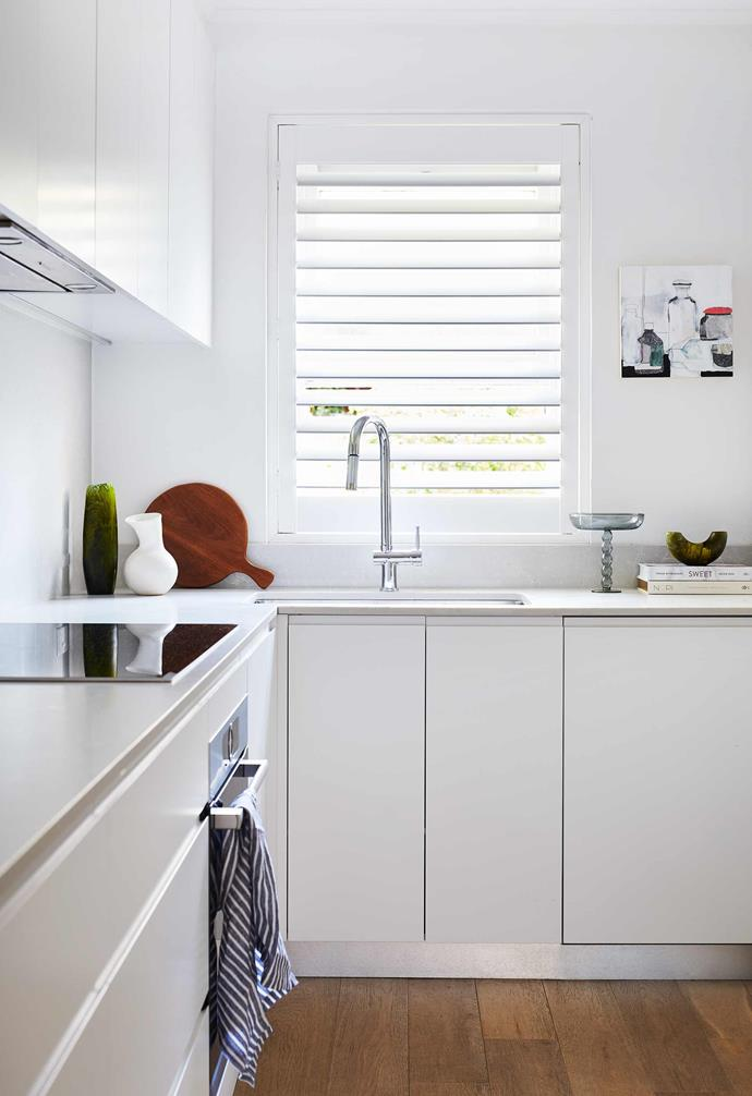"**Kitchen** The kitchen cupboards are Dulux Lexicon white in a gloss finish, which serve as a contrast to the colour elsewhere. Alpine Mist benchtops, [Caesarstone](https://www.caesarstone.com.au/|target=""_blank""