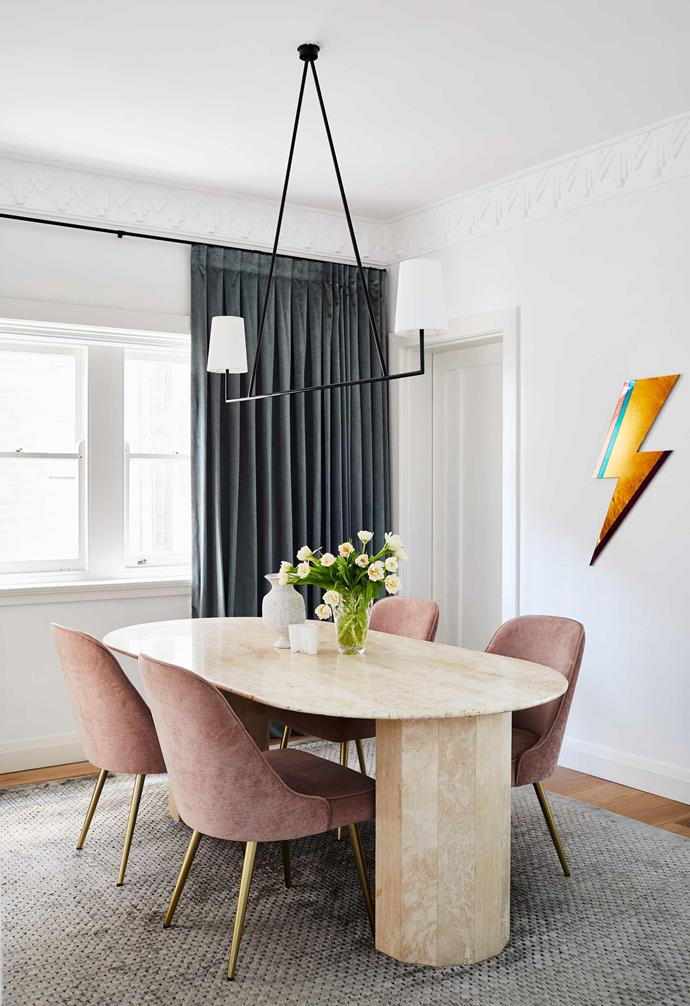 "**Formal dining** The statement dining table is paired with plush pink chairs. Pink dining chairs, [West Elm](https://www.westelm.com.au/|target=""_blank""