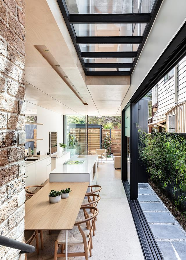 """The kitchen and dining areas in this [renovated heritage home](https://www.homestolove.com.au/heritage-home-receives-an-out-of-the-box-renovation-21019