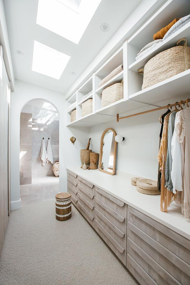 """Due to privacy concerns, walk-in-wardrobes are notoriously dark spaces. Kyal and Kara Installed a series of skylights into the master suite area of their [Mediterranean-meets-coastal home](https://www.homestolove.com.au/kyal-and-kara-build-home-central-coast-20276