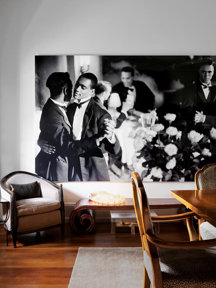 Pas de Deux with Roses, a film still from Isaac Julien's Looking for Langston (1989). One of a pair of 1930s French ebonised bergères attributed to Jules Leleu. Artemide 'Boalum' lamp by Gianfranco Frattini. A c1940s Australian Queensland maple dining table with chairs covered in a Colefax and Fowler animal print velvet on the front and a solid linen on the back. Custom rug from Tibet Sydney.