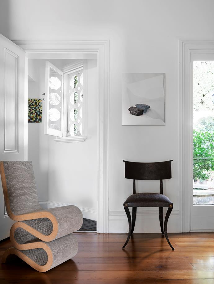 In the entrance hall Frank Gehry's 'Wiggle' cardboard side chair from his 1972 Easy Edges furniture series sits with a wrought-iron chair, above which hangs gallery artist Izabela Pluta's work, *Mirage*, a chromogenic print on metallic paper from her 2018 series 'Abstruse terms and general uncertainties'. Behind the open window is a 1998 untitled work by Simon Blau.