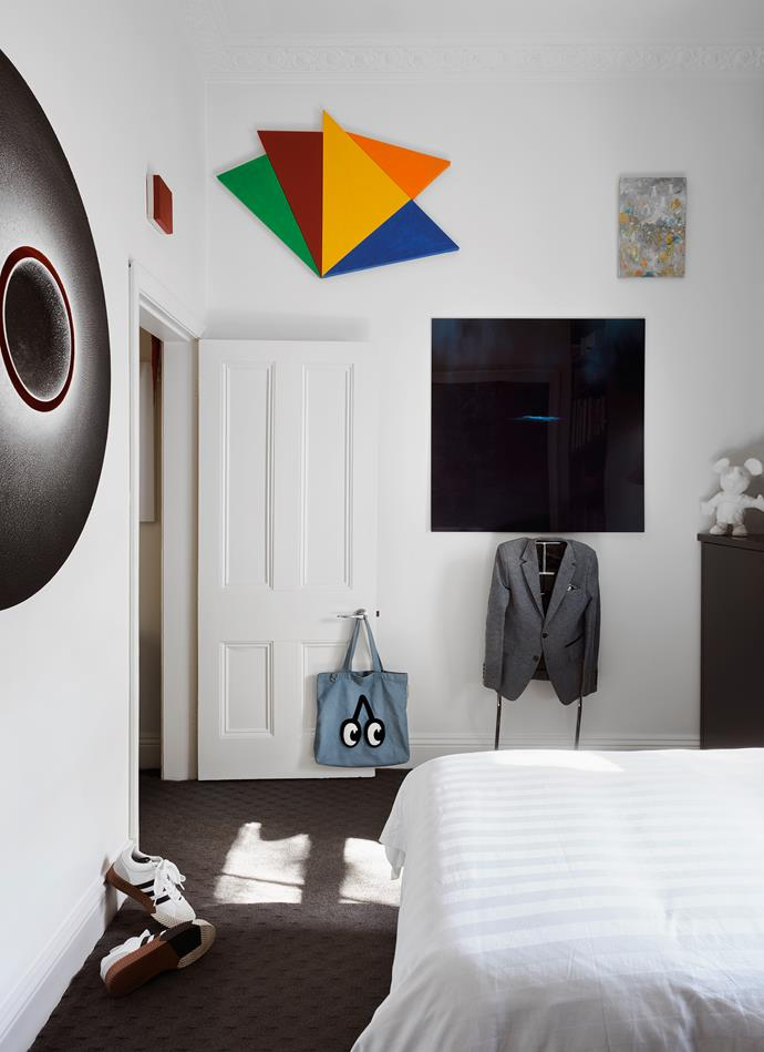 Above the door in Christian's bedroom is a small red work by John Nixon. Other works include the multi-coloured *Infinex Lumina 11* by Sydney Ball and a circular piece by Marion Borgelt. Bag from Supernormal restaurant, Melbourne. 'Mandu' valet by Eckart Muthesius from Anibou.
