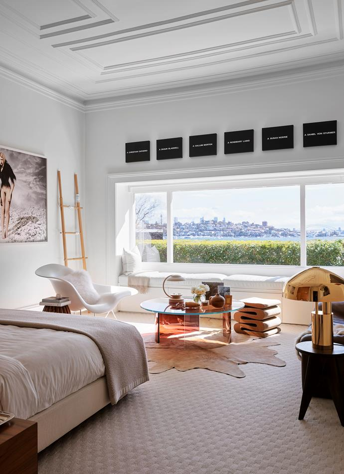 Hanging above the bed in the main bedroom is a large work by gallery artist Lisa Reihana, PELT Pilosus. Vitra 'La Chaise' lounge chair by Charles and Ray Eames and Frank Gehry's 'Wiggle' stool sit around gallery artist Rive Roshan's Colour Dial Table. On the Vitra 'Solvay' stool by Jean Prouvé is Ross Gardam's 'Ora' desk lamp.