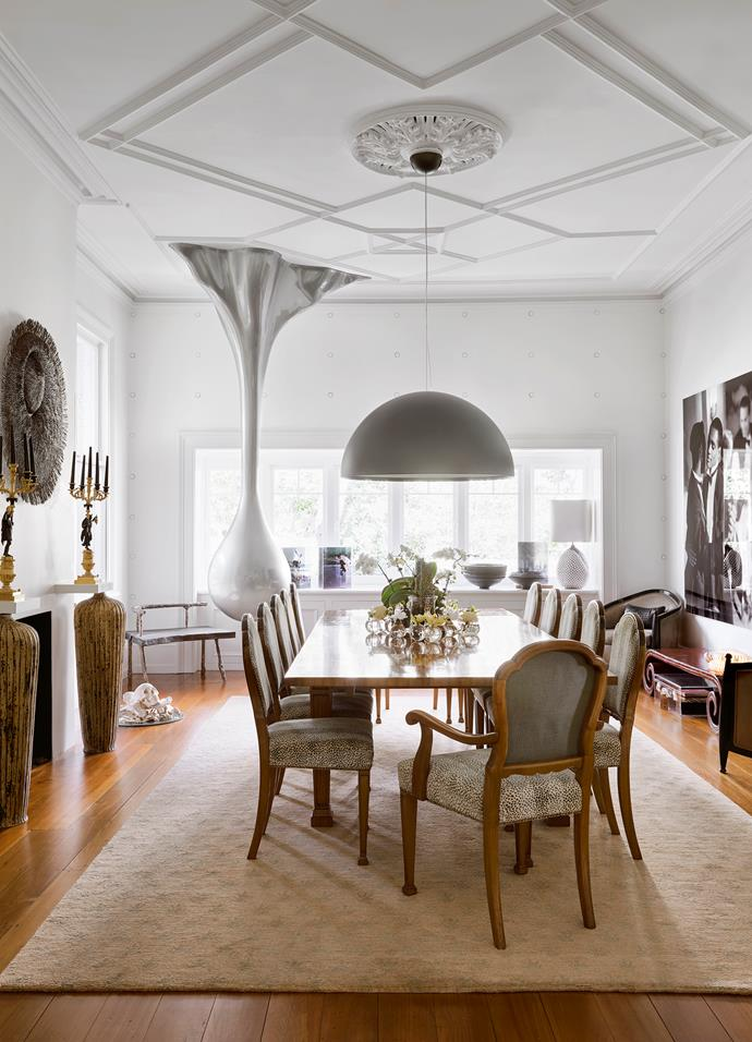 Poised in the dining room is a striking silver sculpture by Sydney artist Nell, The Last Drip, which required the roof to be opened up to reinforce the ceiling to safely and securely install the work. The c1940s dining room setting in Queensland maple includes chairs upholstered on the front in a luxurious animal spot velvet, Colefax and Fowler's 'Malabar', with a solid linen on the back.