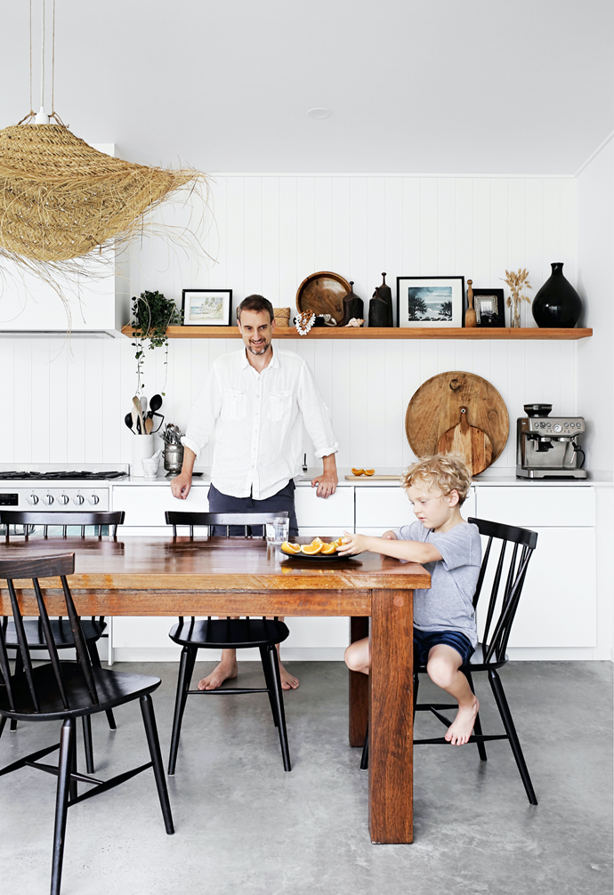 """A favourite place to congregate is the kitchen, where Ian and Max enjoy a snack. """"It links the front [living areas](https://www.homestolove.com.au/living-room-essentials-3466