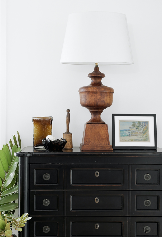 In the living area, Kim and Ian brought the reproduction American antique drawers from the US. She found the lamp on Gumtree, and the artwork is by the home's prior owner.