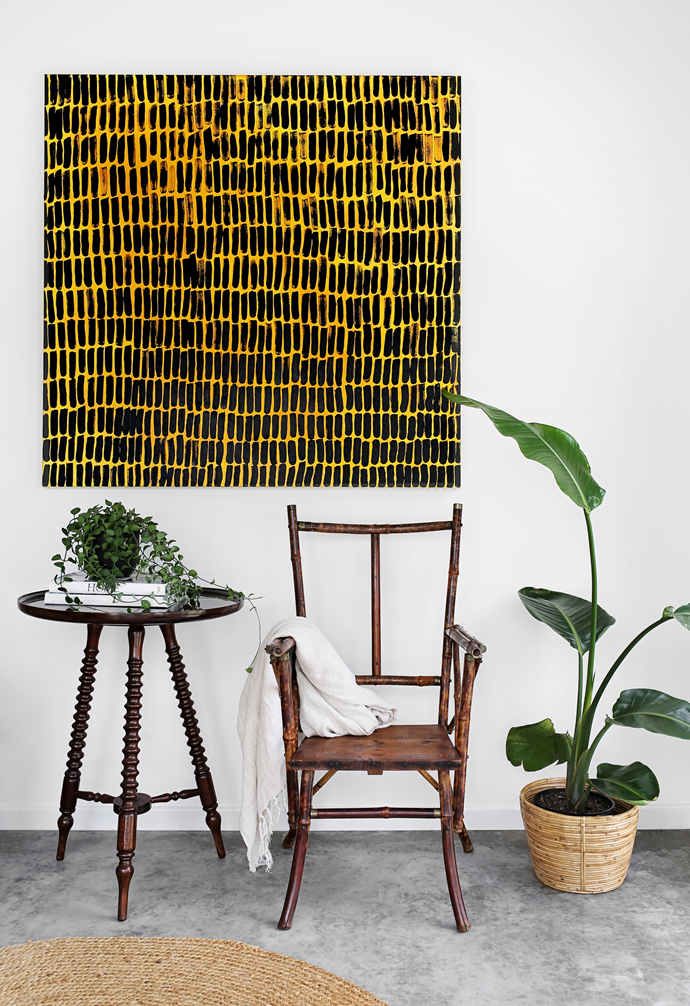 One of Kim's dramatic artworks adorns a reading corner outside the bedrooms. The table and chair are Gumtree finds.