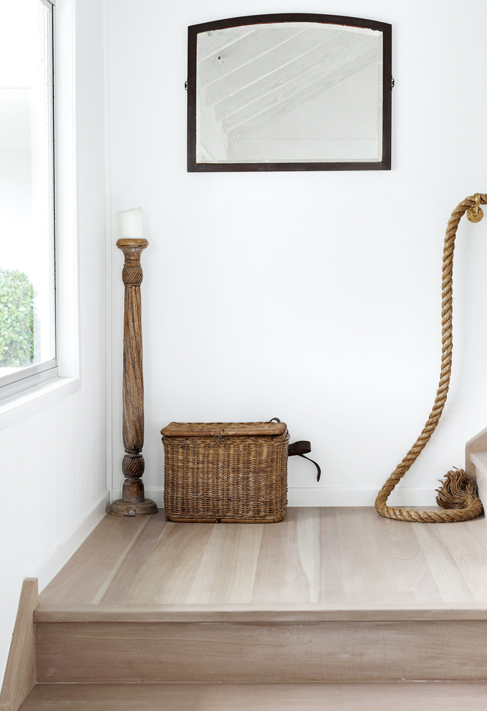 On the first-floor landing, the light and wicker chest are both from Gumtree.