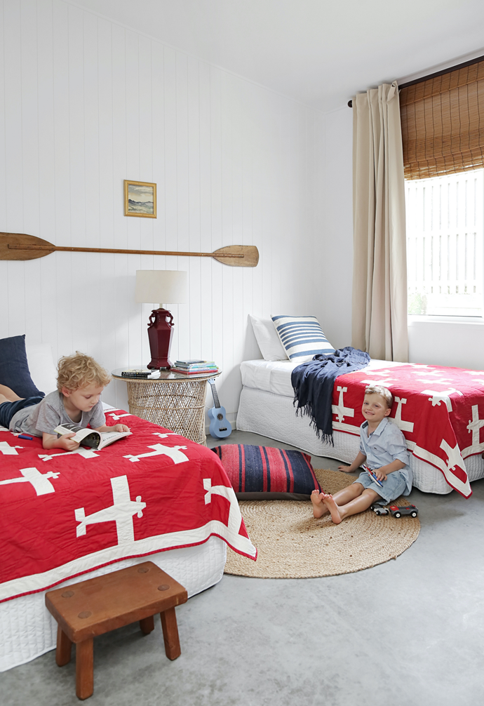 """Sure, there are plenty of beds to choose from in this holiday home, but Max and Tate love bunking together. Appliqué quilts that Kim had custom made in the US when she was expecting the twins present a splash of colour. """"I found an image of an old quilt that had planes on one side, and I decided to have a map of Paris on the back of the quilts, because that is where Ian proposed,"""" she says. """"I stuck with concrete in the bedrooms because, unlike carpet, it doesn't trap sand and feels great underfoot, particularly in summer,"""" adds Kim."""
