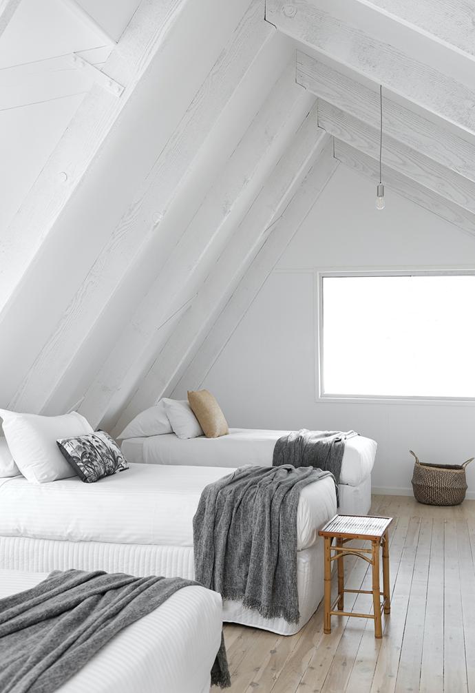 Grey Ikea throws accent the bedroom loft.