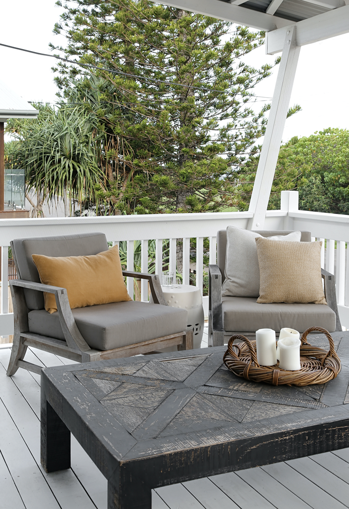 Teak outdoor furniture has silvered over time on the deck.