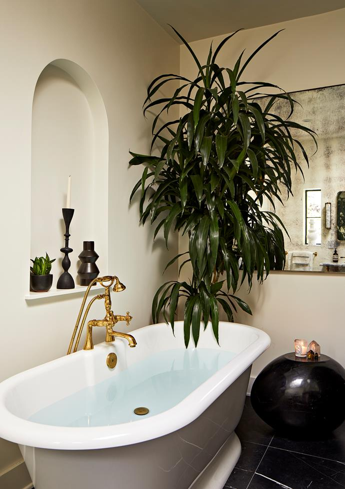 The bathtub in the master bathroom came from Victoria + Albert while the 'Julia' tapware was found at Waterworks.