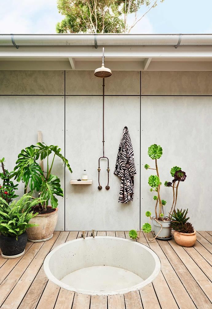 **Outdoor shower** An outdoor shower was a clever addition to the home, especially given the family's love for popping out to the beach.