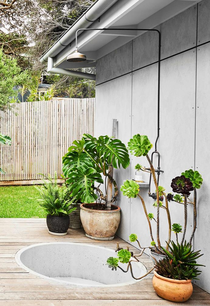 "**Shower deck** ""In winter, it's a bath with a glass of red, and in summer it's straight from the beach and into the [outdoor shower](https://www.homestolove.com.au/outdoor-shower-checklist-20973