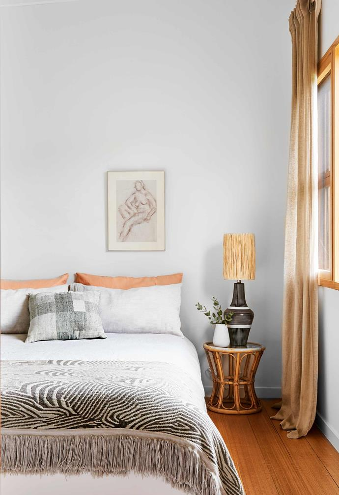 """**Guest room** In this original part of the house, vintage and contemporary pieces join forces to inviting effect. A cane table (from Sophie's Nan's house) and rattan-shaded lamp found on [eBay](https://www.ebay.com.au/