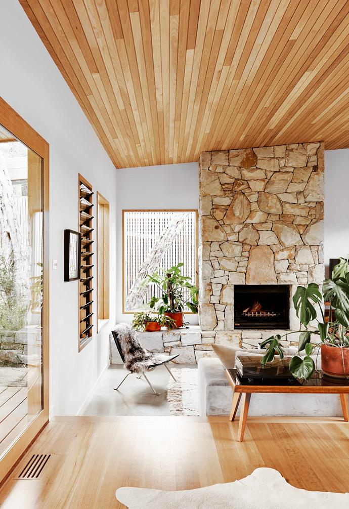 """**Living area** Sophie doesn't hesitate when asked to nominate her favourite room. """"Definitely this sunken lounge,"""" she says. """"It's intimate, cosy and light-filled. My favourite feature is the Gippsland Stone fireplace."""""""