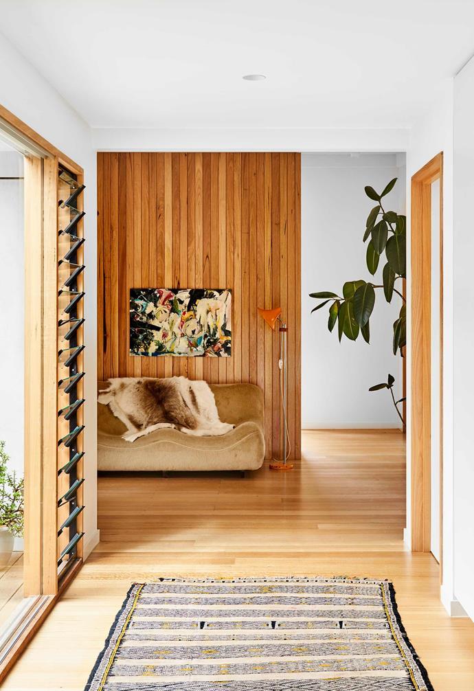 "**Hallway** A Moroccan runner leads the way to the living domain, where a sofa found at Melbourne's [Smith Street Bazaar](https://smithstreetbazaar.com/ target=""_blank"" rel=""nofollow"") beckons. Vintage floor lamp, Leonard Joel. Artwork by Daisy Watkins-Harvey."