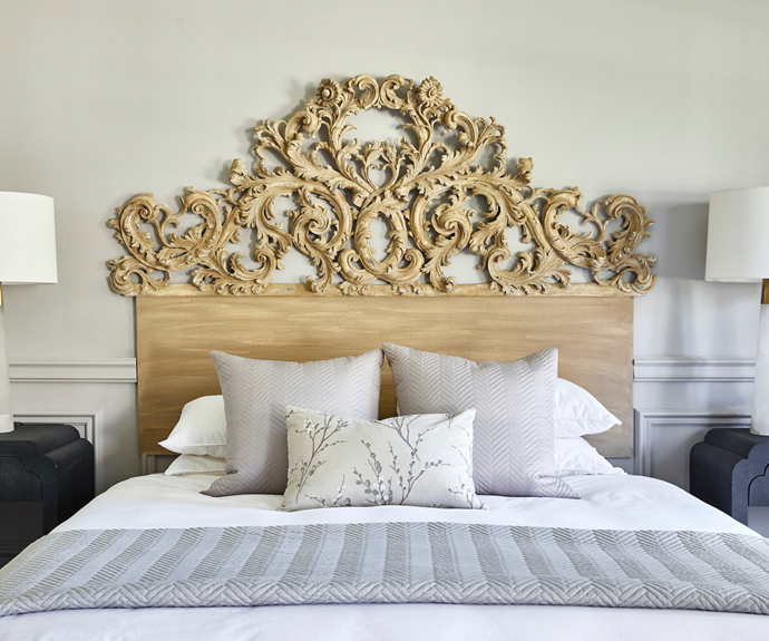 """Joumana designed her sumptuous bedroom around an extravagant hand-carved bedhead found at Laura Kincade, a store the interior designer regularly returns to for one-of-a-kind finds. """"It's very ornate, but I fell in love with it!"""" she says. """"I knew it would make a massive statement, so I calmed it down with some contemporary finishes."""""""
