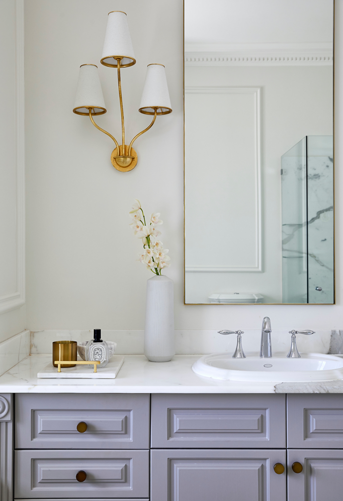 Wall sconces from Circa Lighting add a touch of bling to the couple's ensuite.