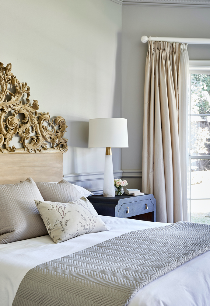 They include Sheridan bedlinen and a Private Collection throw. Regency Distribution bedside tables complement the piece without fighting for attention, and are topped with Visual Comfort x Aerin 'Alabaster' lamps from Bloomingdales. Curtains by Katkalloo are a romantic touch.