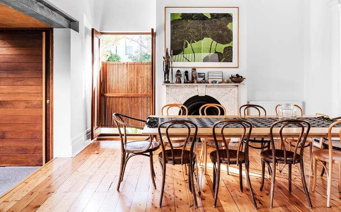 Joe made the dining table himself. Dining chairs, Thonet. Artworks by Ralph Kiggel.