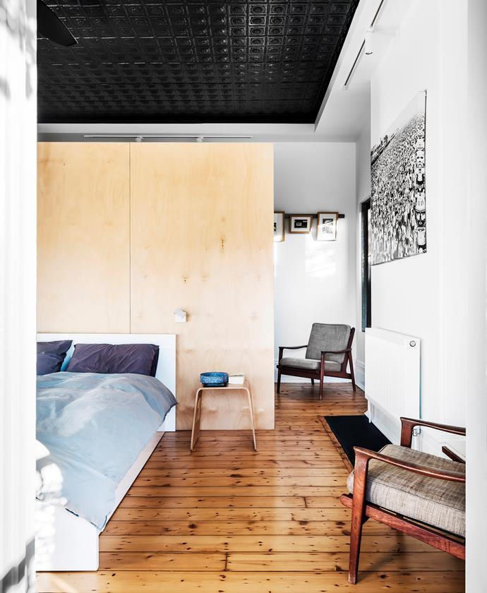 The pressed metal on the ceiling, now painted black, is original to the house. The Parker chairs once belonged to Kate's parents. Stool, Ikea. Codex wall lights, Unios. Prints by Masako Meida (rear wall) and Weegee (right).