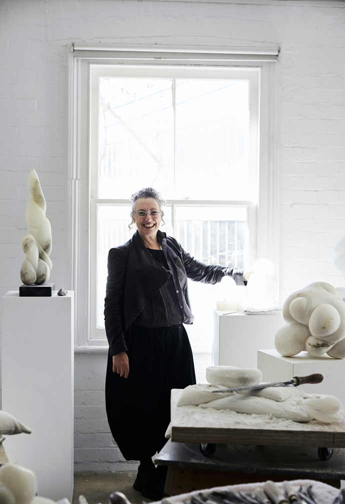 """Carol, pictured here in her studio sanctuary, which she describes as """"otherworldly."""""""