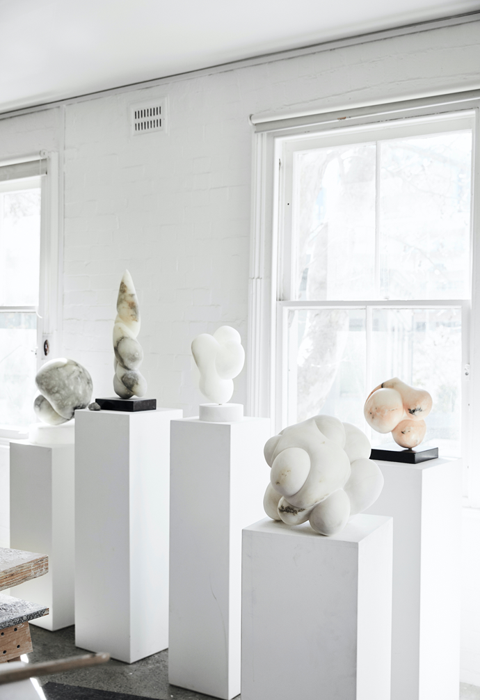 A series of sculptures command her workspace, illuminated by the dappled light in her north-facing studio.