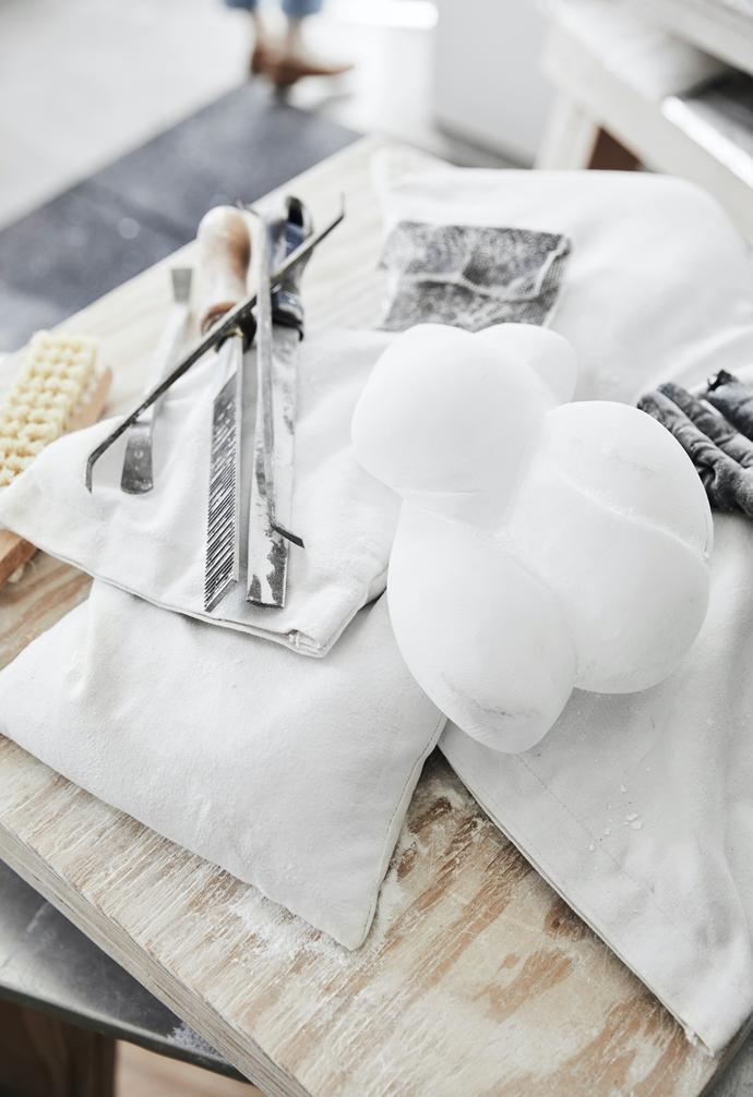 A milky white alabaster nodule rests in Carol's studio.
