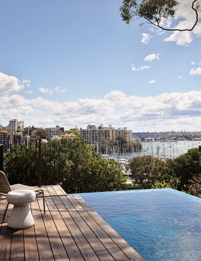 On the lowest of the three levels, a rumpus room abuts an infinity-edge pool with views over the treetops to the harbour. Gervasoni outdoor armchair and ottoman by Paola Navone from Anibou.
