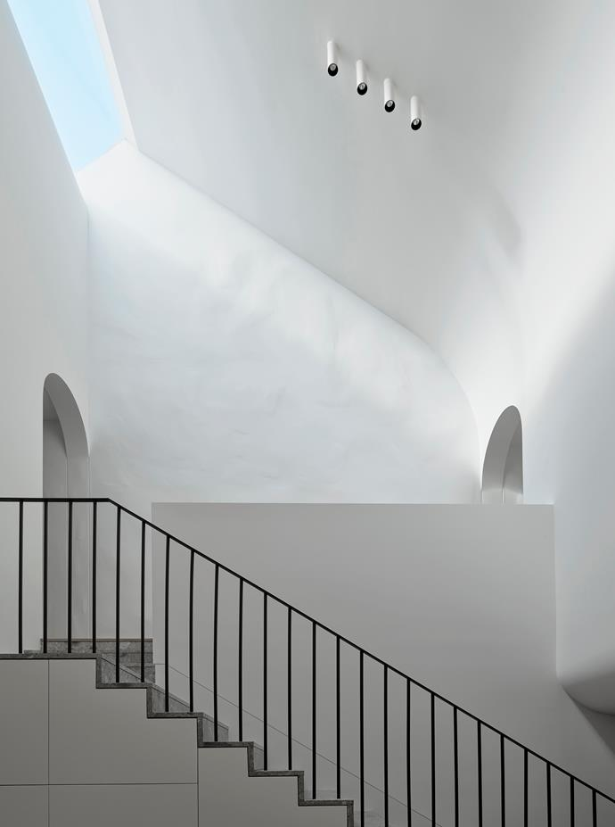 The skylights at the top of the void soak the living level with sunlight.