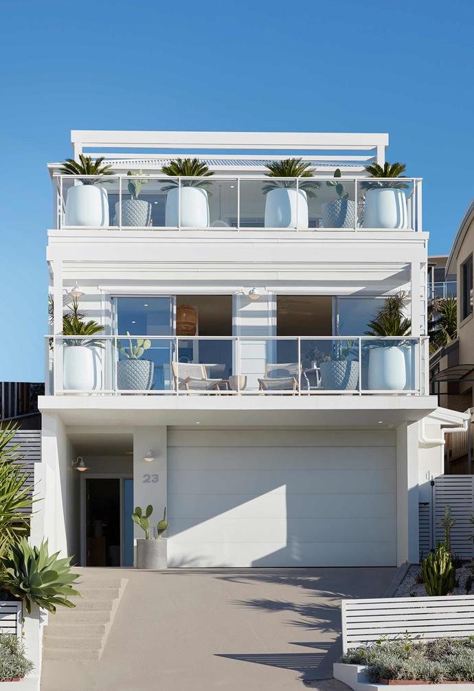 A crisp white exterior instantly embodies coastal charm.