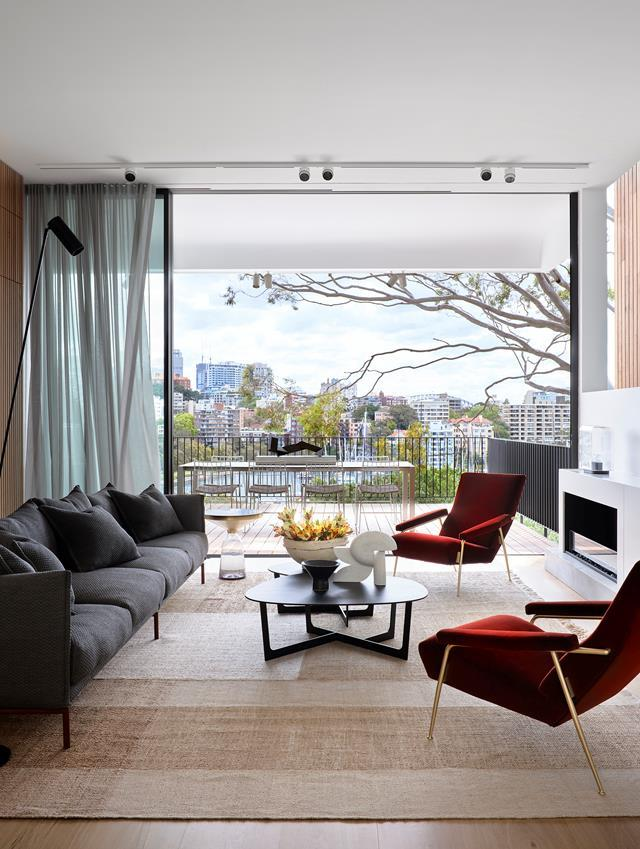 """Towering triple-height windows on one side of this [modern home](https://www.homestolove.com.au/modern-three-level-home-sydney-harbour-22160