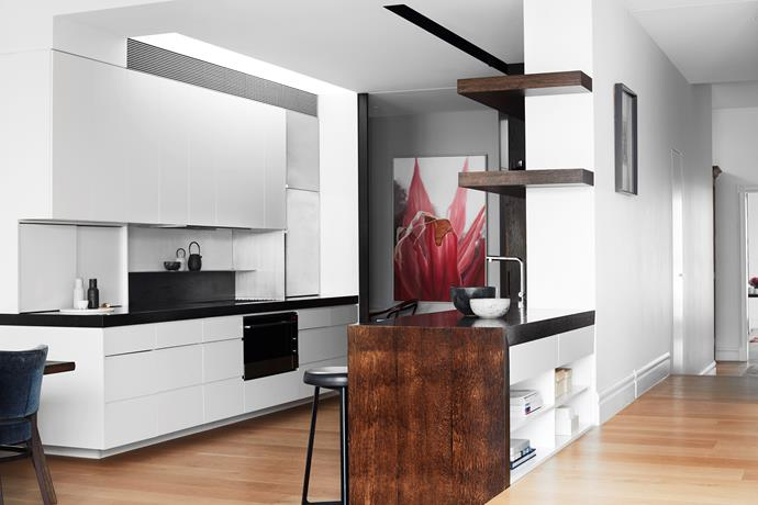 A striking artwork by Stephanie Tetu presides over the kitchen. Joinery by Premier Commercial Interiors and oak bench stained with black japan.