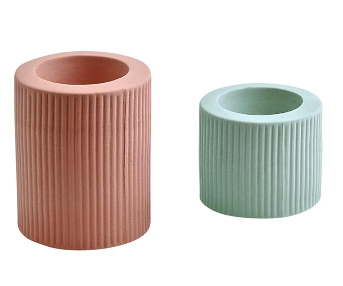 """Ribbed Infinity candle holder in Ochre, $19, and Blue, $14, [Marmoset Found](https://marmosetfound.com.au/