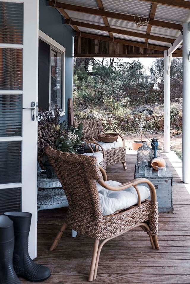 "Surrounded by sand dunes and scrub heath, the front verandah of a [beach shack in Esperance WA](https://www.homestolove.com.au/blue-beach-shack-22169|target=""_blank"") is a private retreat for its artist owner Allira Henderson."