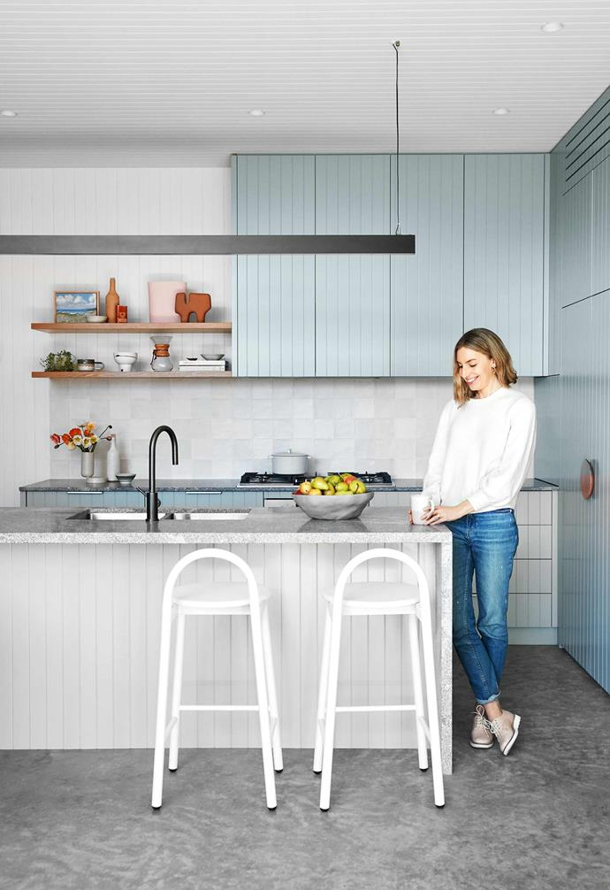 """**Kitchen** Designed by Caitlin, the cabinetry is V-groove panelling in a two-pack polyurethane finish matched to the soft green of [Dulux](https://www.dulux.com.au/ target=""""_blank"""" rel=""""nofollow"""") Waltzing. Joinery by [Timberline](https://timberlinebp.com.au/ target=""""_blank"""" rel=""""nofollow""""). Neo granite benchtop, [Surface Gallery](https://surfacegallery.com.au/ target=""""_blank"""" rel=""""nofollow""""). Gunmetal tapware, [ABI Interiors](https://www.abiinteriors.com.au/ target=""""_blank"""" rel=""""nofollow""""). Bobby stools, [DesignByThem](https://www.designbythem.com/ target=""""_blank"""" rel=""""nofollow""""). Overhead lights, [BoscoLighting](https://www.boscolighting.com.au/ target=""""_blank"""" rel=""""nofollow"""")."""