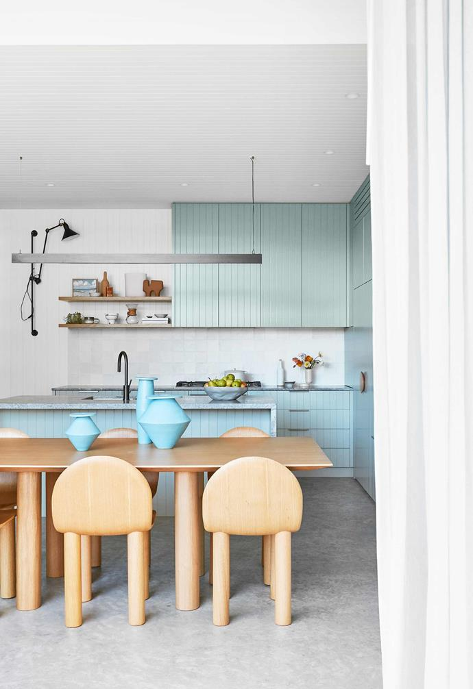 """**Dining space** To the side of the sliding doors is a recess where the curtains can be stacked. """"I designed it behind the joinery so the curtains have somewhere to sit when they're open, which lets in more light,"""" says Caitlin. Arch dining chairs and Earth dining table, all by [Sarah Ellison](https://sarahellison.com.au/ target=""""_blank"""" rel=""""nofollow"""") and from [Life Interiors](https://www.lifeinteriors.com.au/ target=""""_blank"""" rel=""""nofollow""""). La Lampe Gras wall light, Curious Grace. Blue vases and BZippy & Co vessels, [Jardan](https://www.jardan.com.au/ target=""""_blank"""" rel=""""nofollow"""")."""