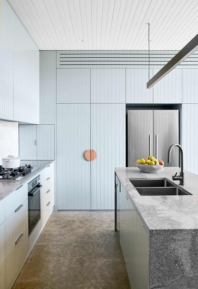 """**Kitchen** """"I love the polished concrete floor; it's super smooth underfoot, and nice and cool in summer,"""" says Caitlin. Honed Neo Granite, [Surface Gallery](https://surfacegallery.com.au/ target=""""_blank"""" rel=""""nofollow"""")."""